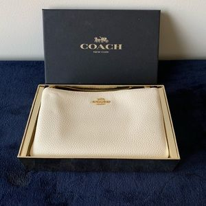 Coach Clutch cream color